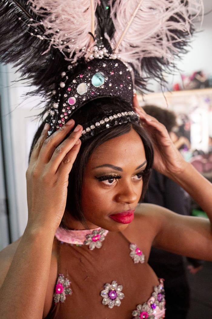 """Vegas! The Show"" dancer Lauren Clark prepares for the opening scene in the dressing ..."