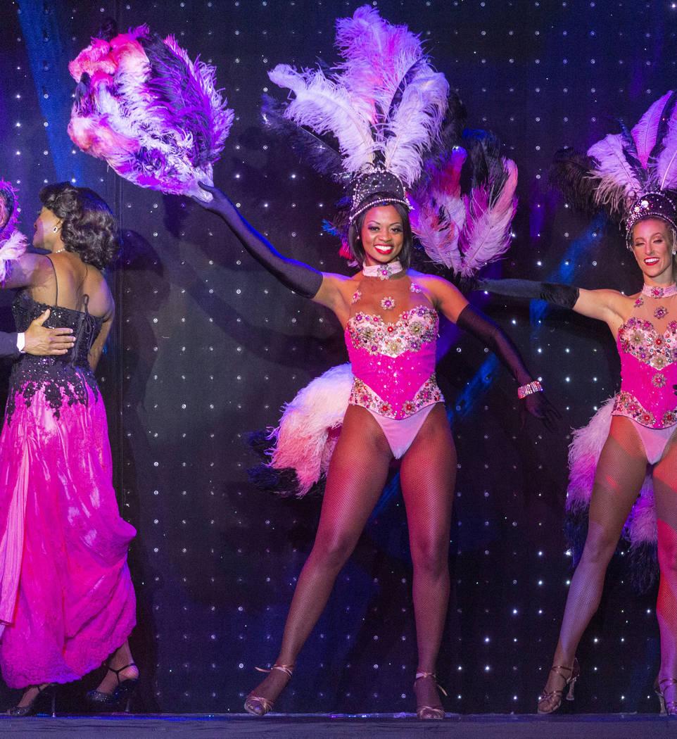 """Vegas! The Show"" dancer Lauren Clark, center, preforms at the Saxe Theater at the Mi ..."