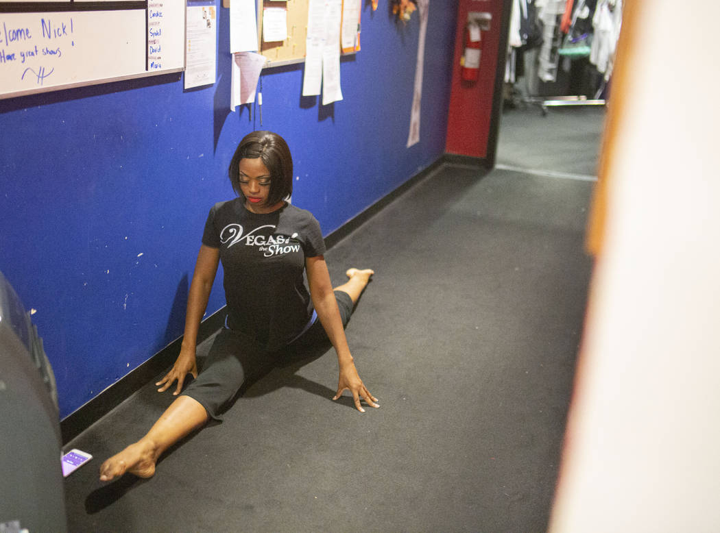 """""""Vegas! The Show"""" dancer Lauren Clark stretches before a show, backstage of the Saxe ..."""