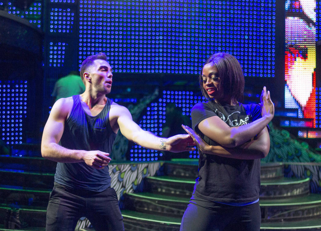 """Vegas! The Show"" dancers Nick Miller, left, and Lauren Clark run through choreograph ..."