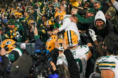 Green Bay Packers kicker Mason Crosby celebrates kicking the game-winning field goal by jumping ...