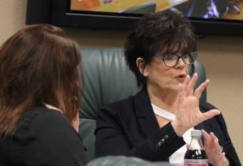Nevada State Board of Dental Examiners Executive Director, Debra Shaffer-Kugel, right, speaks d ...