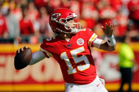 Kansas City Chiefs quarterback Patrick Mahomes (15) throws a pass during the first half of an N ...