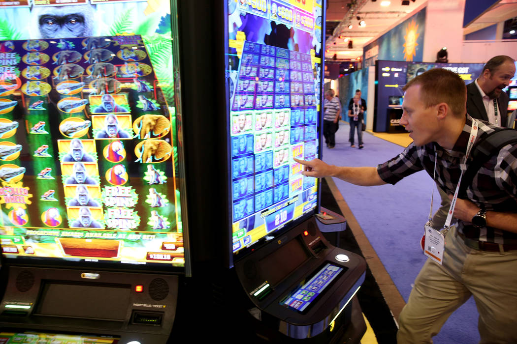 Kyle Sadlik of Hunt Valley, Md. plays Money Roll at the Incredible Technologies booth at the 20 ...