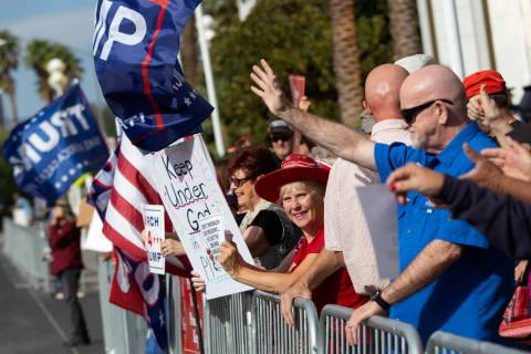 Trump supporters cheer as vehicles honk at the March for Trump on Thursday, Oct. 17, 2019, outs ...