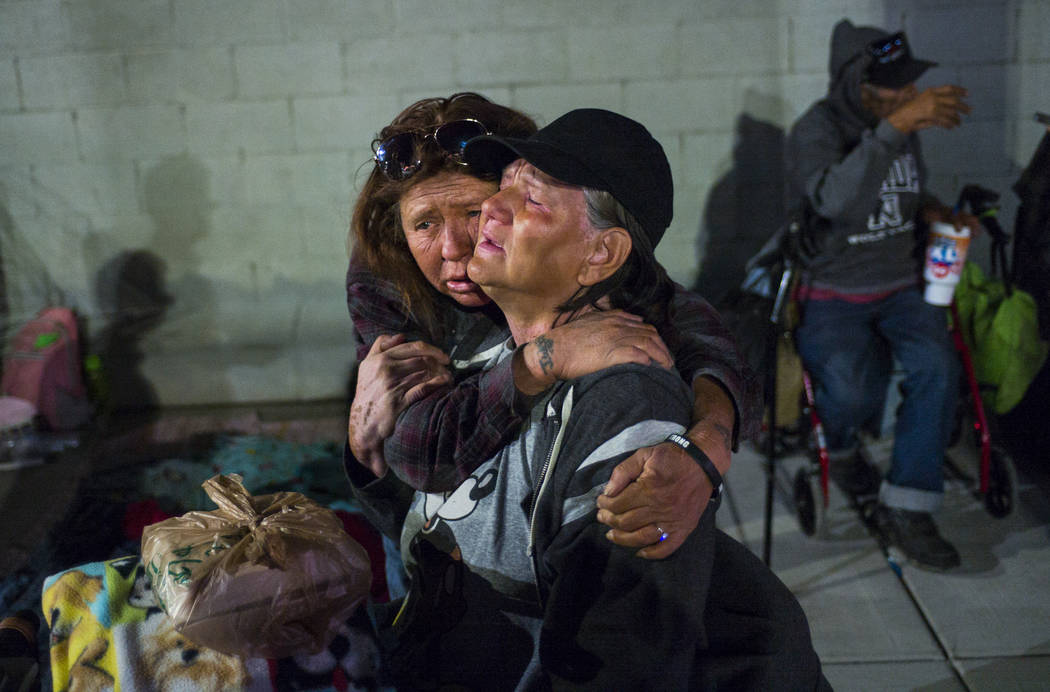 Alice Pate, left, comforts Kathleen Sutton as she talks about the struggles of living on the st ...
