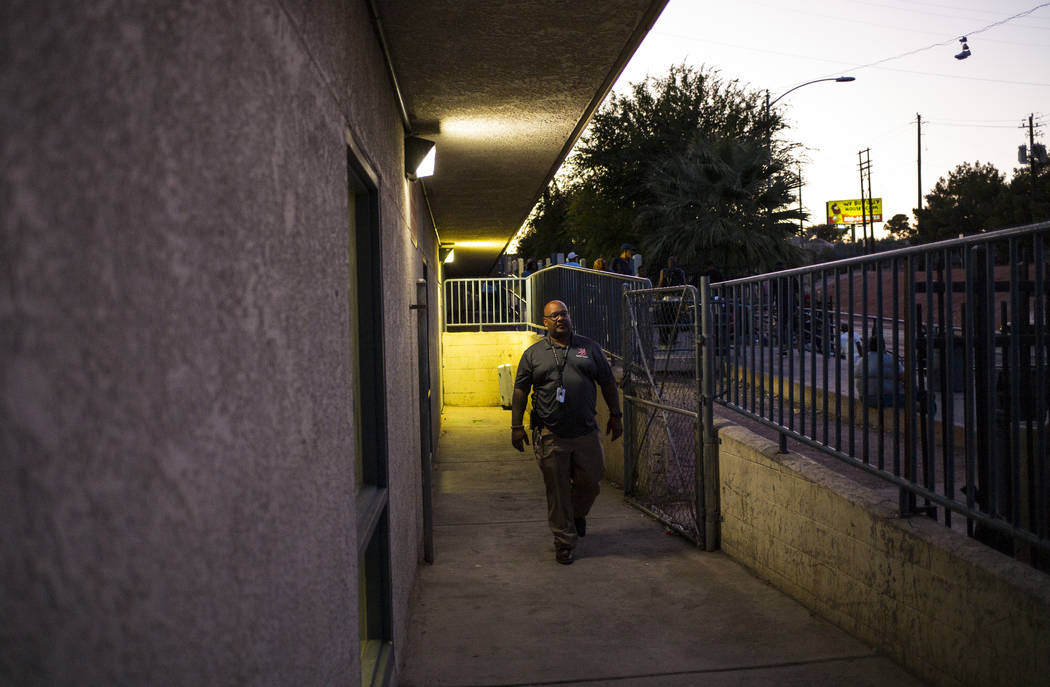 Jawan Mullen, homeless services liason at The Salvation Army, walks by the entrance to the shel ...