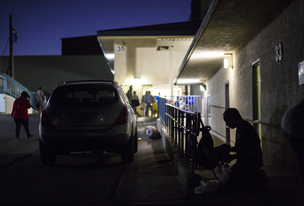 A patron of The Salvation Army homeless shelter, right, checks his belongings at the shelter ne ...