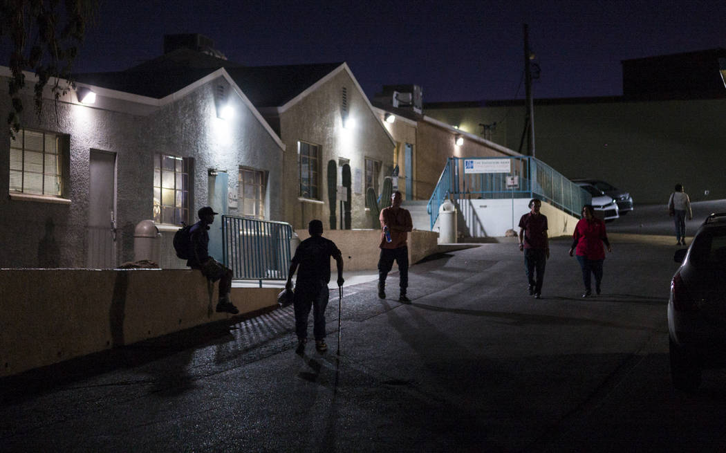 Patrons of The Salvation Army homeless shelter, including Anthony Lowe, second from left, walk ...