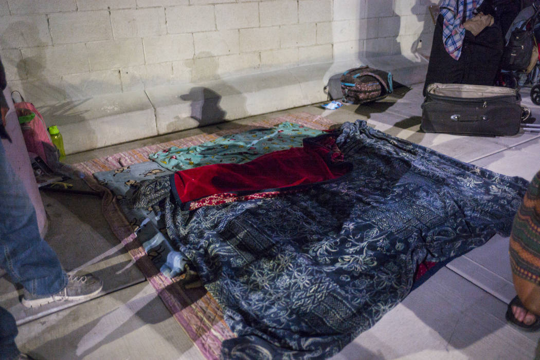 Blankets on the ground as people camp out for the night on Garces Avenue near Main Street in do ...
