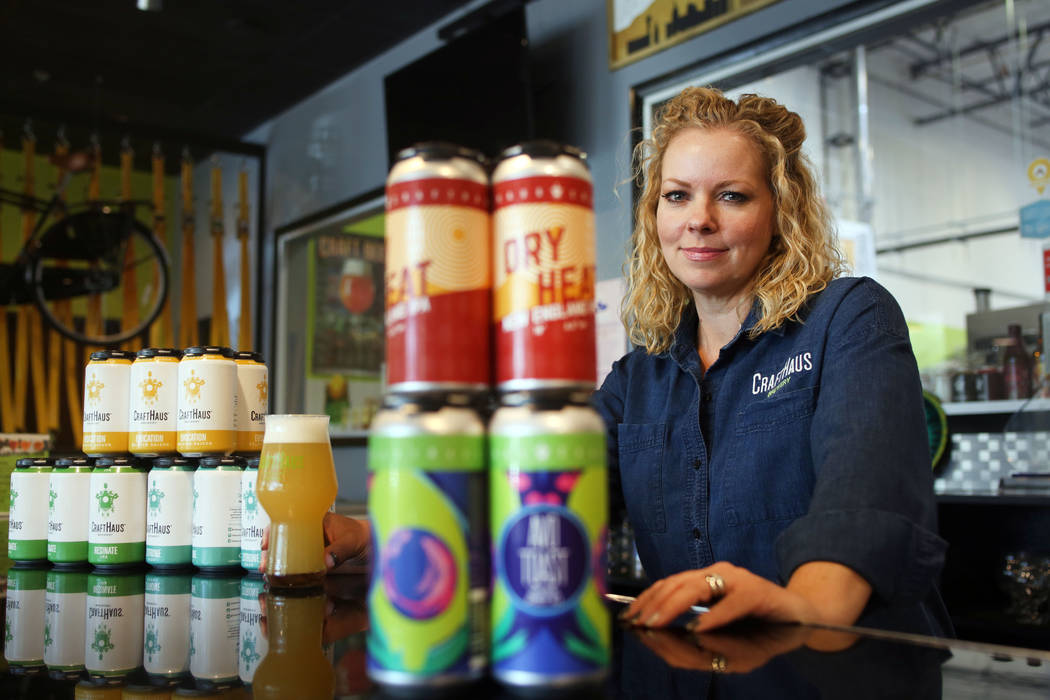 Owner of CraftHaus Brewery Wyndee Forrest displays their in house craft beer in cans which has ...