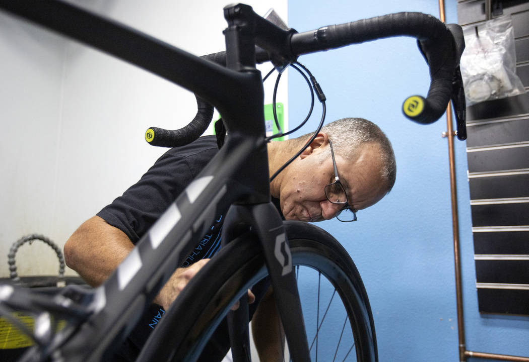 Pro Cyclery employee Shane Broussard fixes a flat tire on a bicycle on Wednesday, Oct. 16, 2019 ...