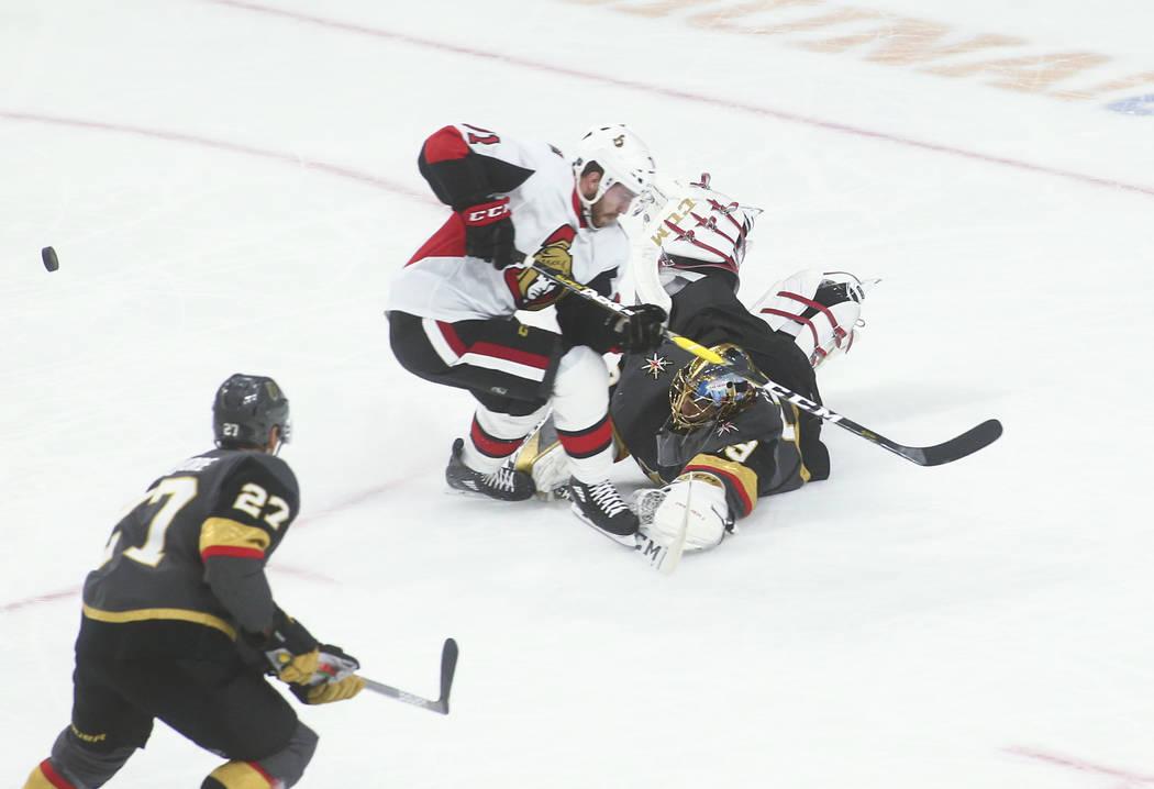 Golden Knights' Marc-Andre Fleury (29) blocks the puck against Ottawa Senators' Chris Tierney ( ...