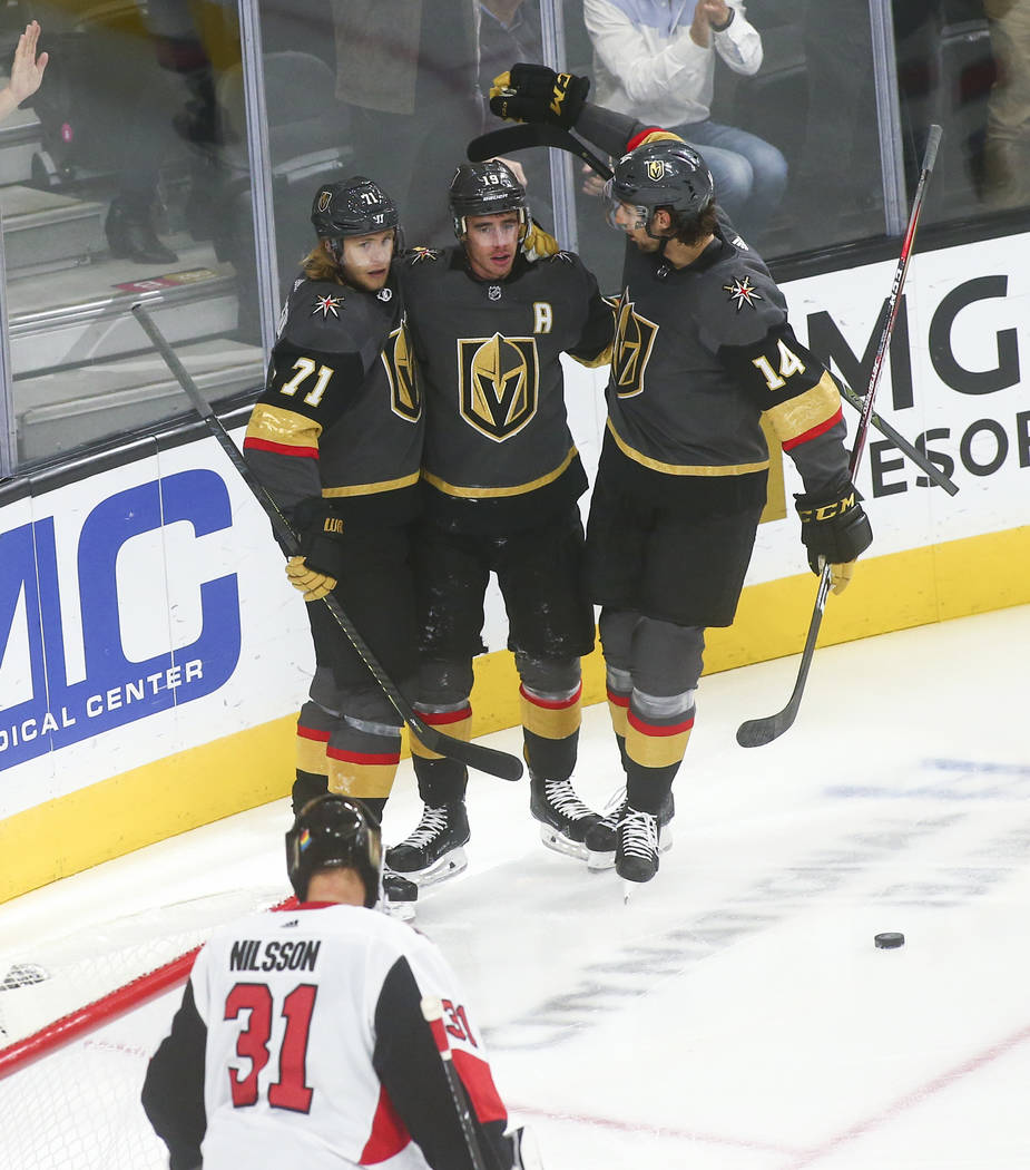 Golden Knights' Reilly Smith (19) celebrates his goal with William Karlsson (71) and Nic Hague ...