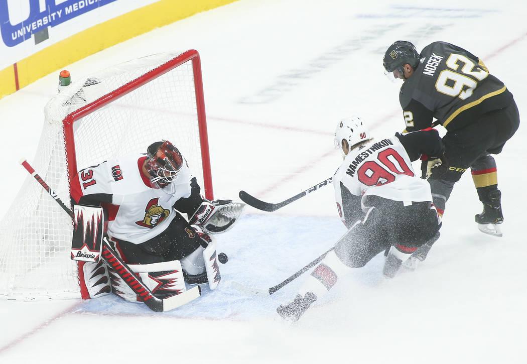 Ottawa Senators goaltender Anders Nilsson (31) blocks a shot from Golden Knights' Tomas Nosek ( ...