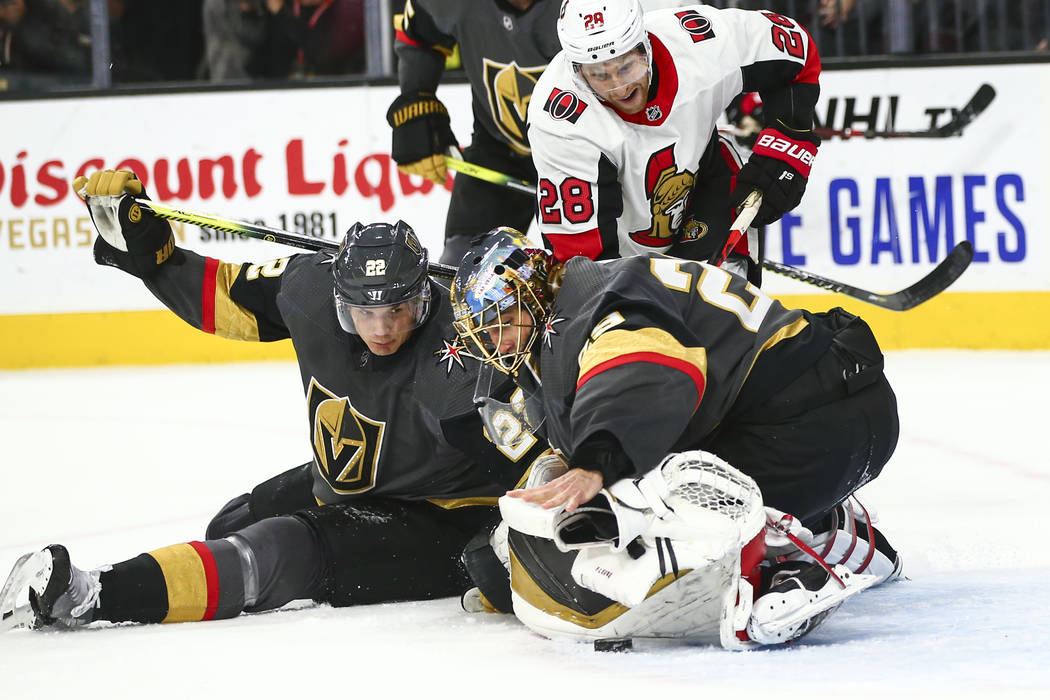 Golden Knights goaltender Marc-Andre Fleury (29) looks to stop the puck with his bare hand afte ...