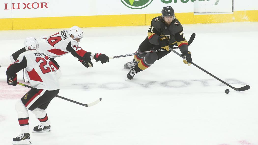 Golden Knights' William Karlsson (71) moves the puck under pressure from Ottawa Senators' Mark ...