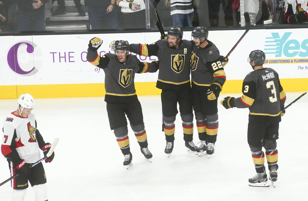 Golden Knights' Nick Holden, third from left, celebrates his goal with, from left, Paul Stastny ...