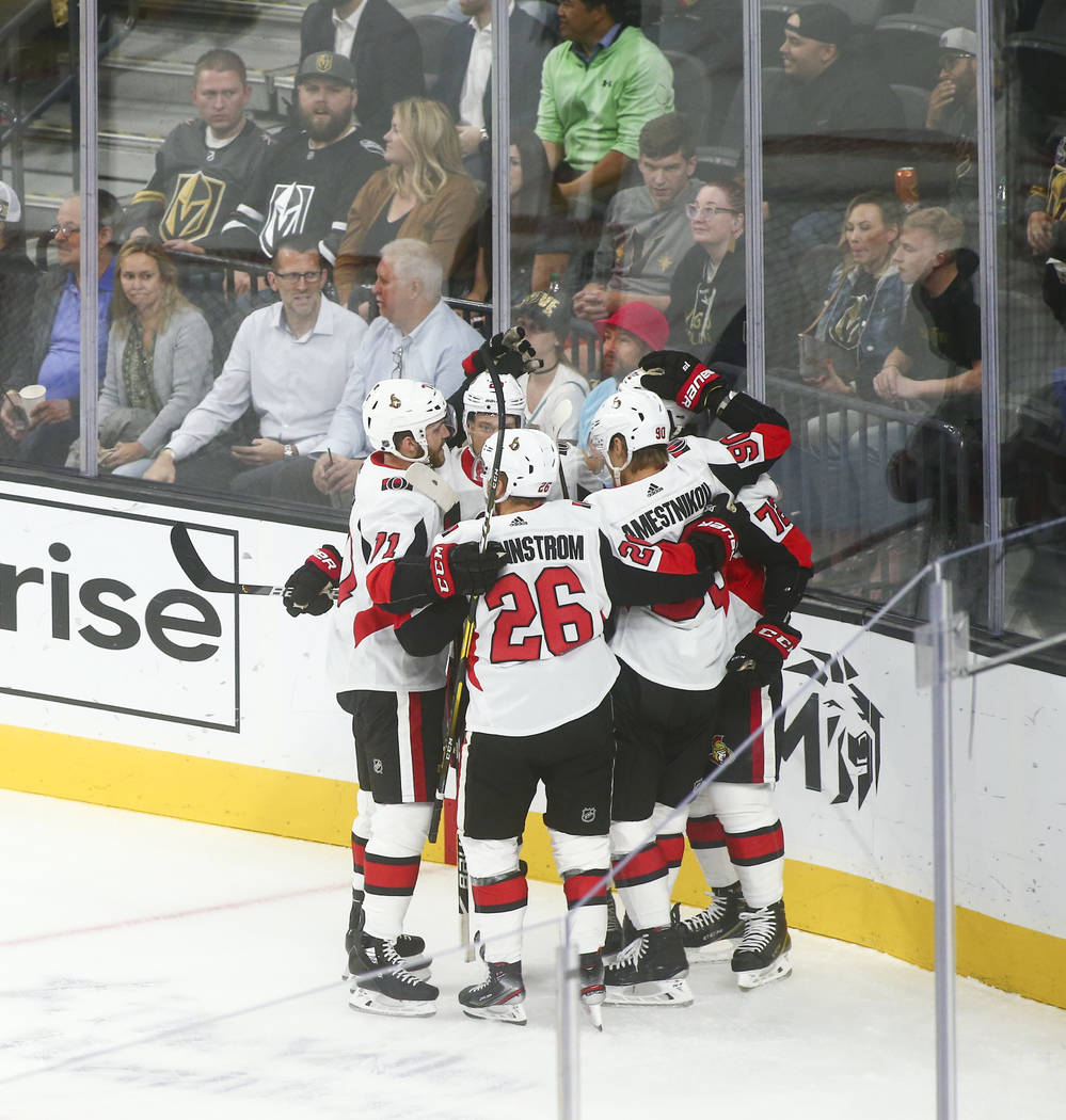 Ottawa Senators celebrate a goal against the Golden Knights during the first period of an NHL h ...