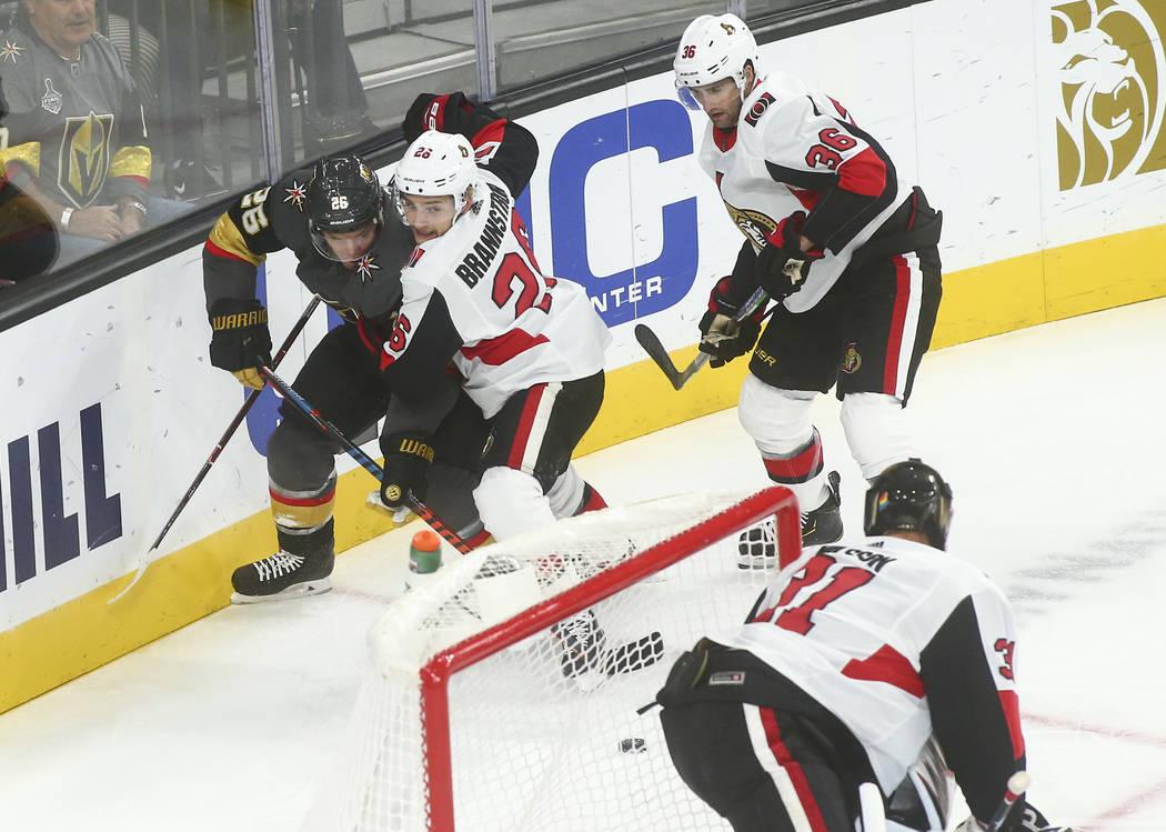 Golden Knights' Paul Stastny, left, battles for the puck against Ottawa Senators' Erik Brannstr ...