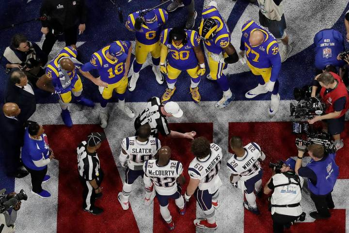 Referee John Parry (132) displays the coin before the coin toss ahead of the NFL Super Bowl 53 ...