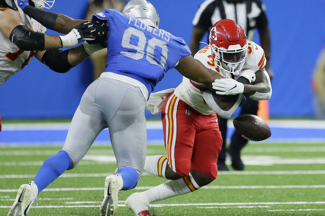 Detroit Lions defensive end Trey Flowers (90) knocks the ball out of the arms of Kansas City Ch ...