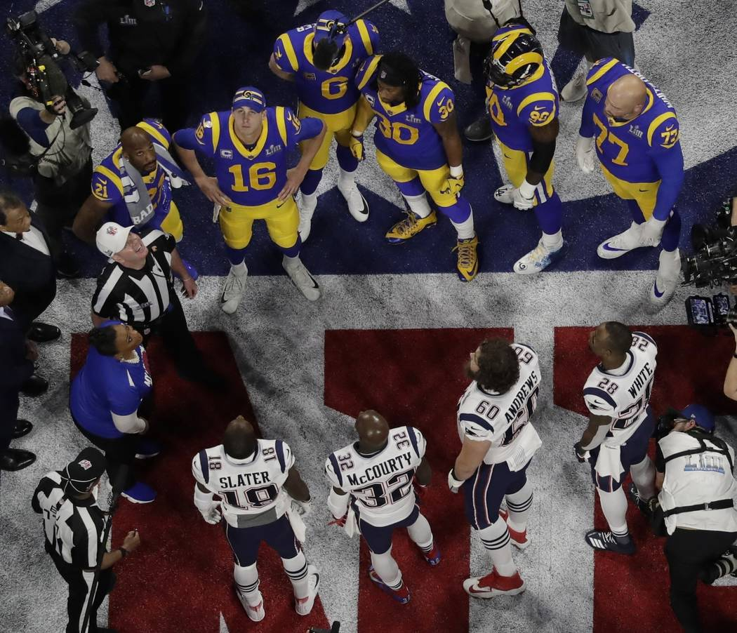 Referee John Parry and players watch the coin toss before the NFL Super Bowl 53 football game b ...