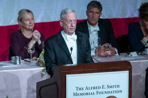 Former U.S. Secretary of Defense Jim Mattis, center, delivers the keynote address during the 74 ...
