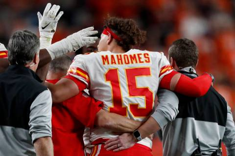 Kansas City Chiefs quarterback Patrick Mahomes (15) leaves the game after getting injured again ...