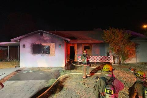 Crews battle a house fire Thursday, Oct. 17, 2019, on the 5700 block of East Cheyenne Boulevard ...