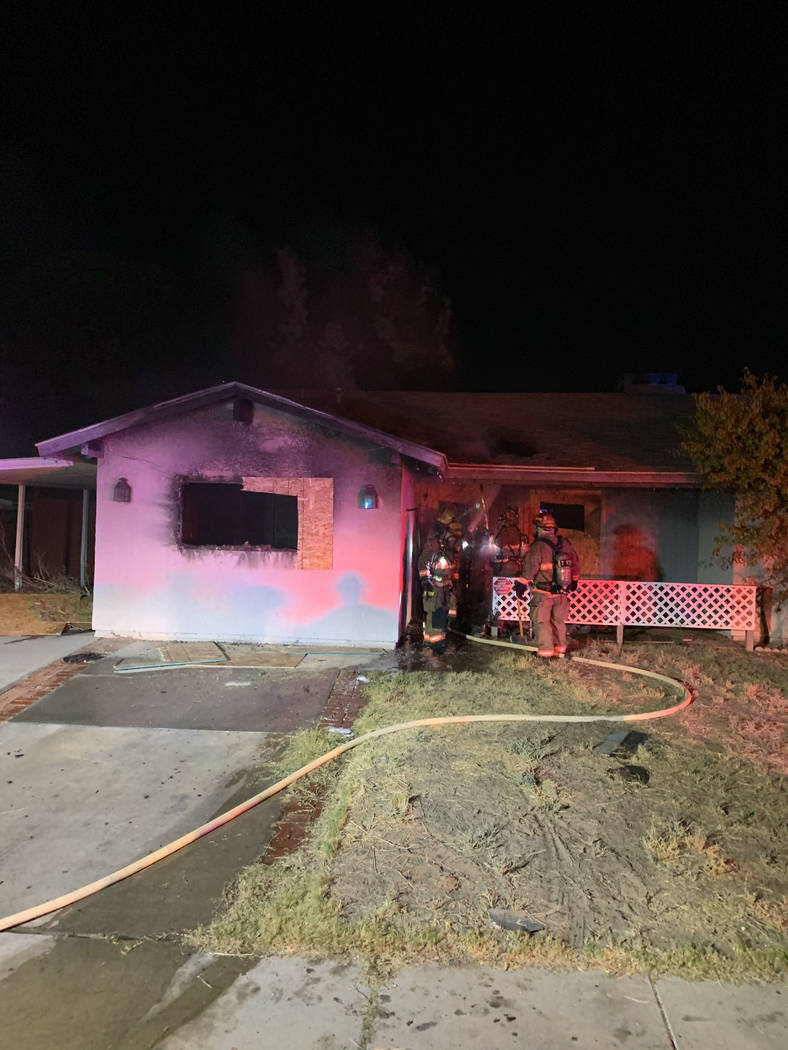 Crews battle a house fire Thursday, Oct. 17, 2019, on the 5700 block of East Cheyenne Boulevard ...
