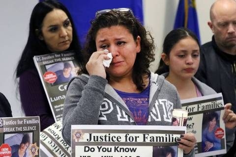 Sheyla Padilla, daughter of Celia Luna-Delgado, a homicide victim from last January, wipes a te ...