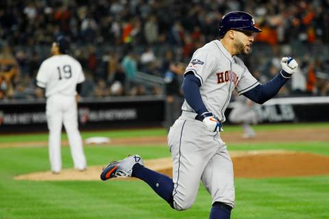 Houston Astros' George Springer, right, celebrates after his three-run home run off New York Ya ...