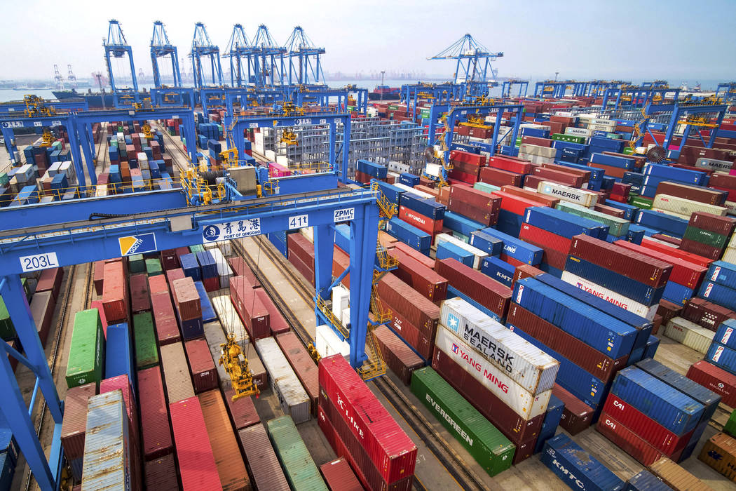In a May 14, 2019, file photo, containers are piled up at a port in Qingdao in east China's Sha ...
