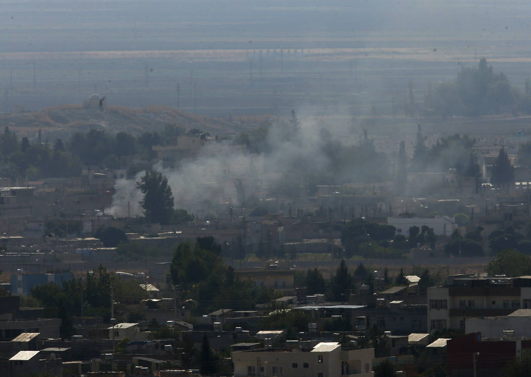 In this photo taken from the Turkish side of the border between Turkey and Syria, in Ceylanpina ...