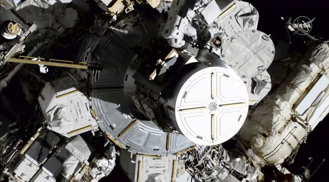 In this photo provided by NASA astronauts Christina Koch and Jessica Meir exits the Internation ...