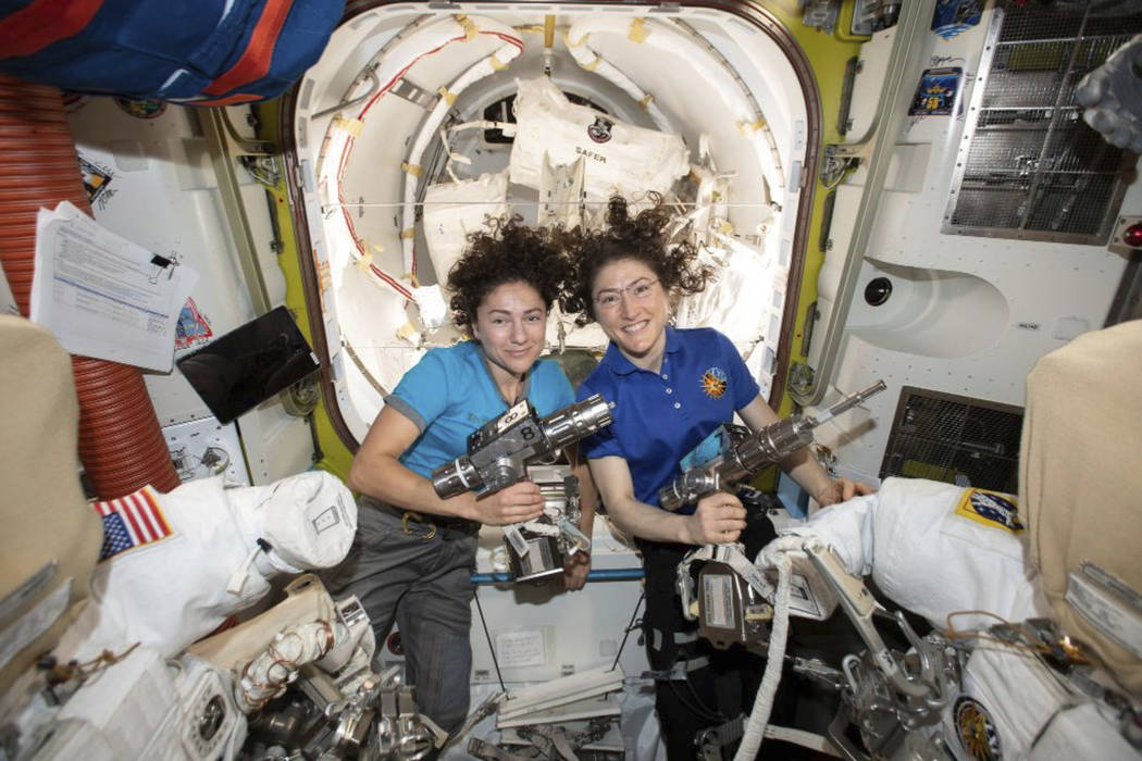 In this photo released by NASA on Thursday, Oct. 17, 2019, U.S. astronauts Jessica Meir, left, ...
