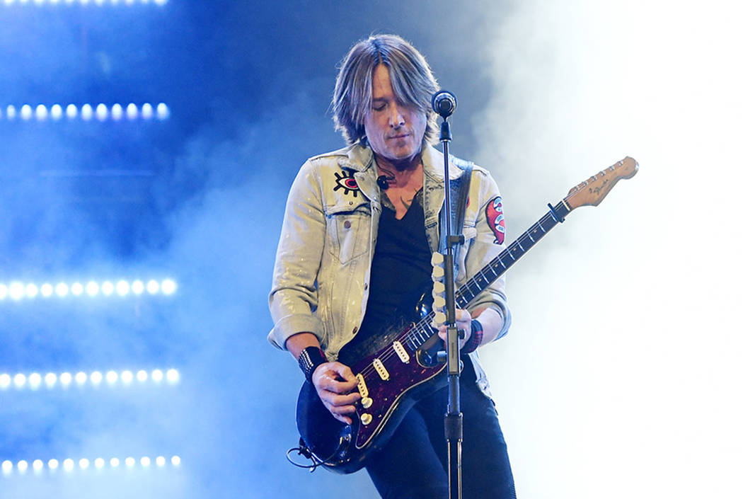 """Keith Urban is shown during his """"Graffiti U"""" tour stop at the Colosseum at Caesars Palace on Fr ..."""