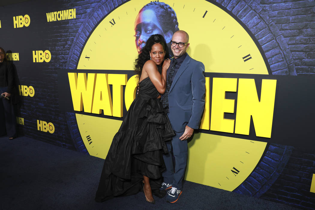 """Regina King and Damon Lindelof attend the """"Watchmen"""" premiere at the Cinerama Dome on ..."""