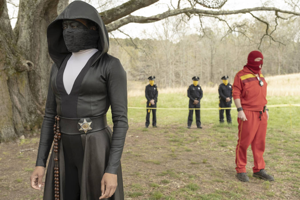 """Regina King as Sister Night and Andrew Howard as Red Scare in """"Watchmen."""" (Mark Hill/HBO)"""