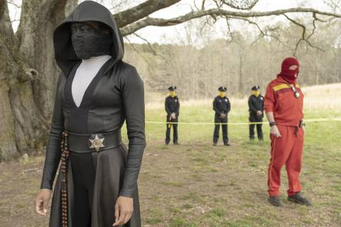 "Regina King as Sister Night and Andrew Howard as Red Scare in ""Watchmen."" (Mark Hill/HBO)"