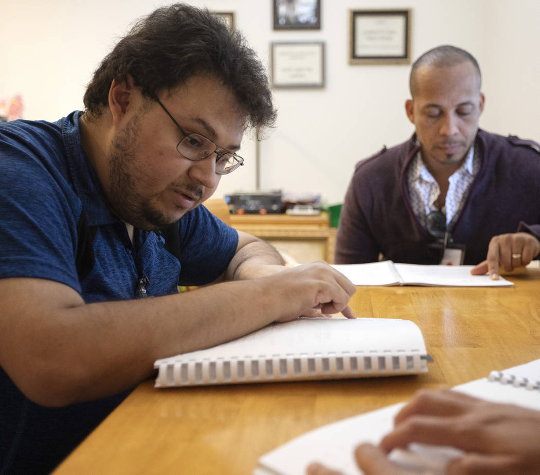 Ivan Medina, left, who is visually impaired due to retina pigmentosa, learns Braille on Friday, ...