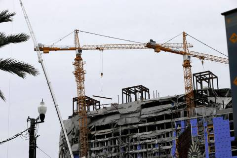 Two unstable cranes loom over the construction of a Hard Rock Hotel, Thursday, Oct. 17, 2019, i ...