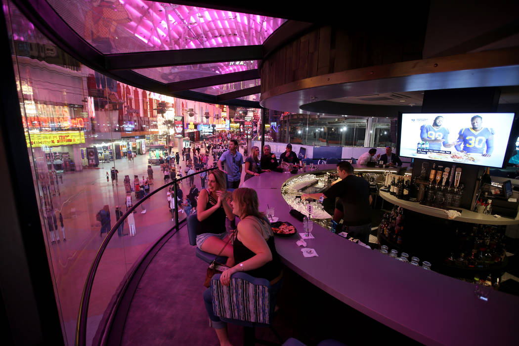 Trista Wells, left, and Sara Peterson, both of Kalispell Montana, at the rotating bar at Whiske ...
