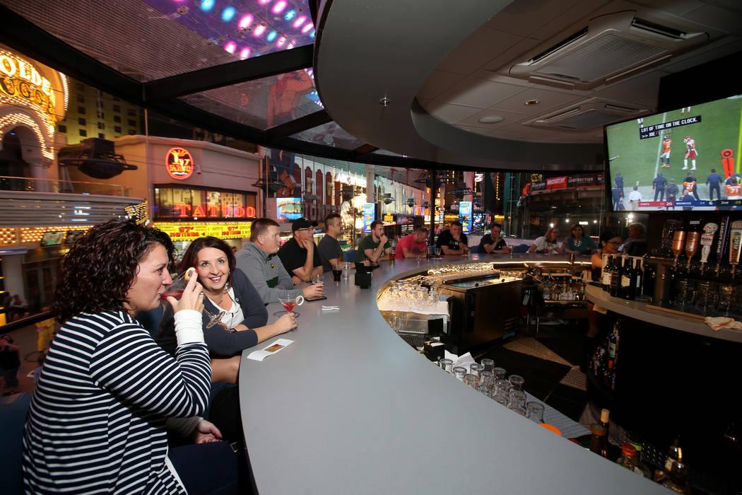 Kim Gullicks, left, and KerryAnn Thompson, both of Bismarck, N.D., at the rotating bar at Whisk ...