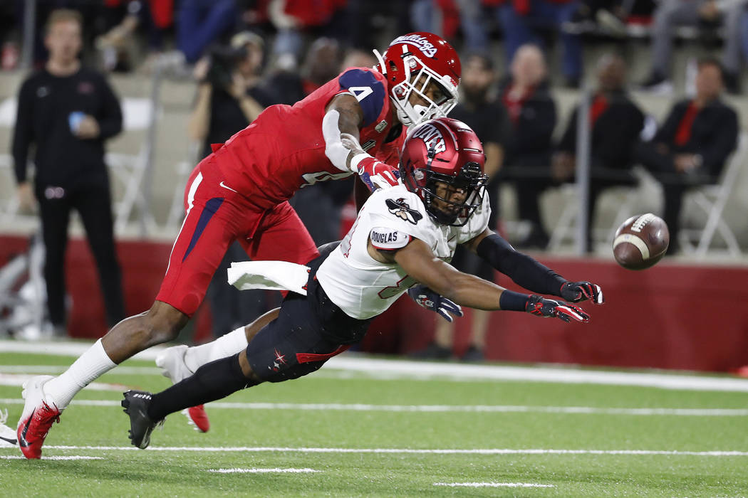 UNLV wide receiver Steve Jenkins tries to haul in a long pass as Fresno State defensive back Wy ...
