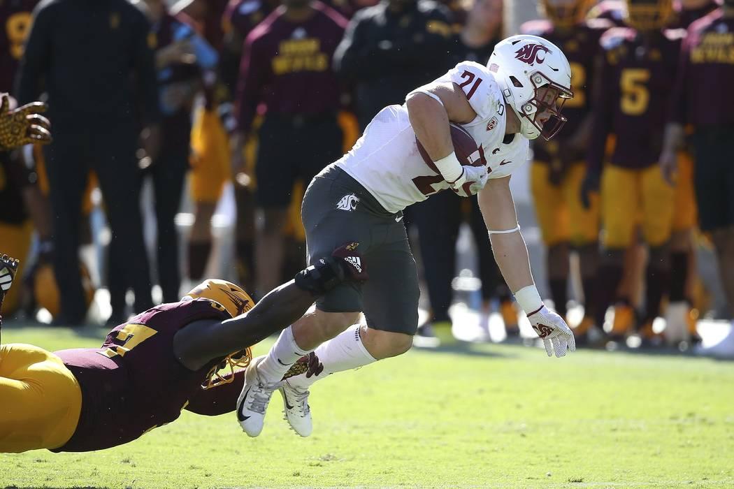 Washington State running back Max Borghi (21) is pulled down by Arizona State linebacker Darien ...