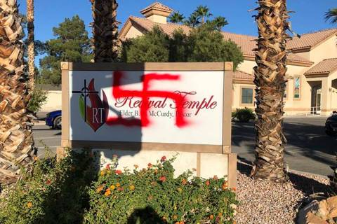 A spray-painted swastika on the sign for the Revival Temple Church of God in Christ. (William M ...