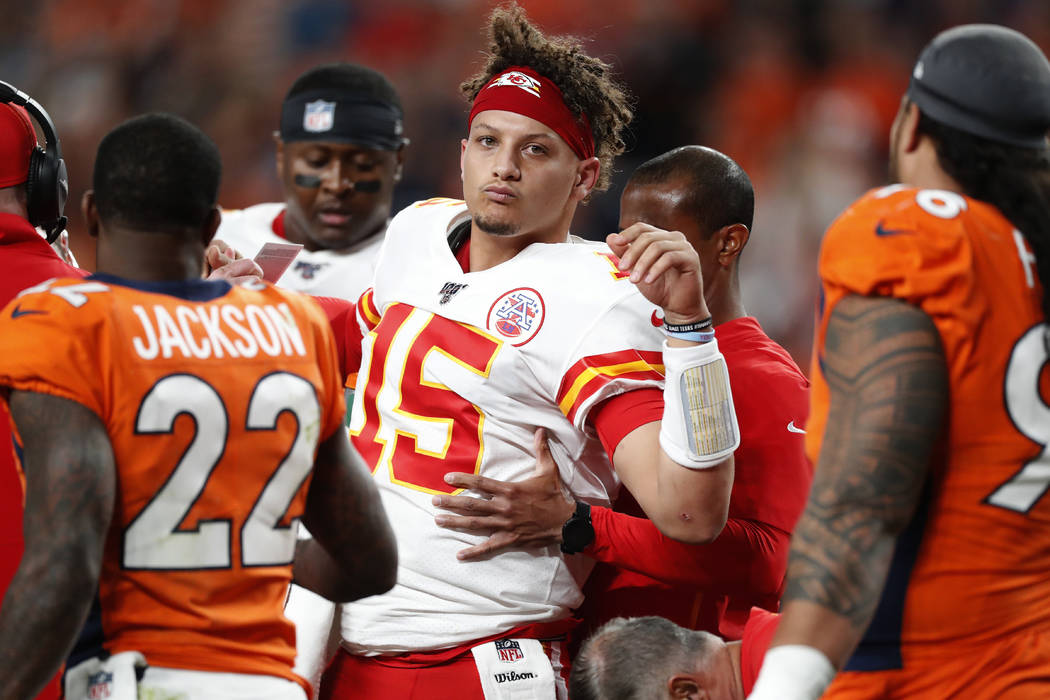 Kansas City Chiefs quarterback Patrick Mahomes (15) is helped off the field after being injured ...
