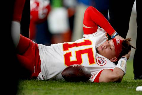 Kansas City Chiefs quarterback Patrick Mahomes (15) lies on the field after being injured again ...